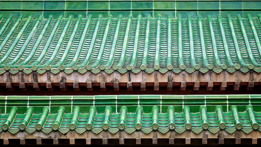 A close-up of King Yin Lei's distinctive green tiled roof.