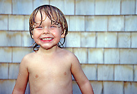 Boy enjoying an outdoor shower, Cape Cod