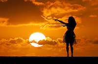 A hula dancer in silhouette at sunset.
