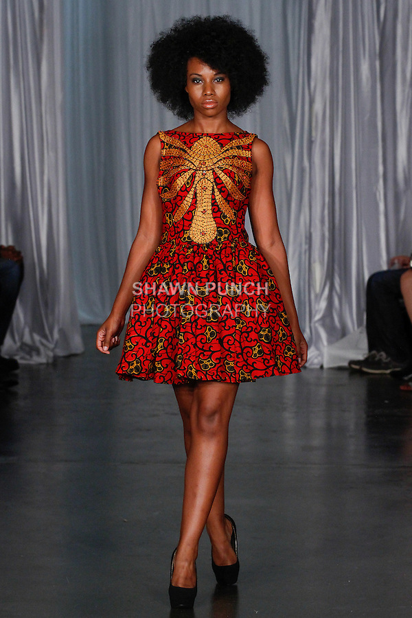 Model walks runway in an outfit from the Rosbinna Spring Summer 2014 collection by Rosemary Iwezor, during Fashion Week Brooklyn Spring Summer 2014, in Brooklyn, New York on October 4, 2013.