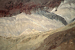 Striation layers of colored rocks bands at the base of the Black Mountains, Death Valley National Park, California
