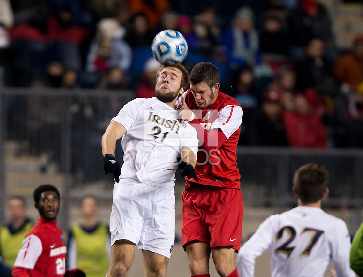 Vince Cicciarelli (21) of Notre Dame goes up for a header with Kyle Venter (12) of New Mexico during the NCAA Men's College Cup semifinals at PPL Park in Chester, PA.  Notre Dame defeated New Mexico, 2-0.