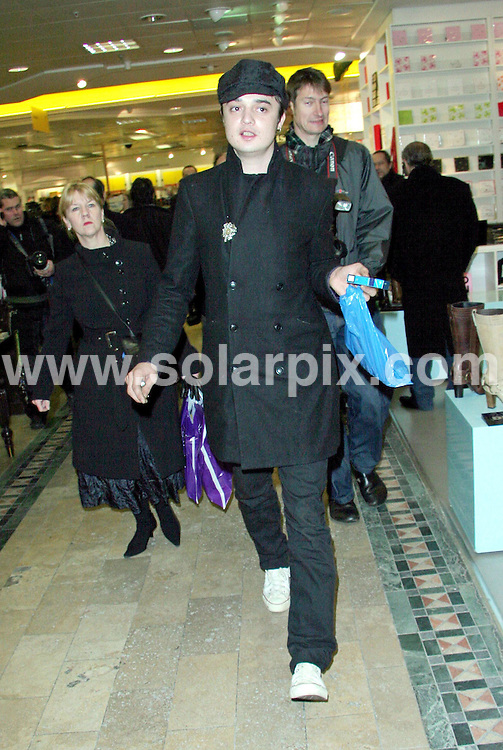 **ALL ROUND PICTURES FROM SOLARPIX.COM**.**WORLDWIDE SYNDICATION RIGHTS**.PAPARAZZI PHOTOGRAPHER RESCUES PETE DOHERTY..Pete Doherty was today expected to join his band Baby Shambles on the roof top car park of Selfridges in a one off special gig to promote trendy Manchester fashion label Gio Goi. As the band waited patiently for the notoriously unpunctual lead singer, a lone London paparazzi photographer spotted Doherty looking lost and wandering aimlessly through the vast shop floor area of the famous London store.  Taking pity on the confused rock star the photographer kindly led him through a maze of clothes racks and fire exits until eventually they found the correct lift that would take Doherty to the roof to join his waiting band members.  Pete thanked the photographer by doffing his hat...DATE: 07/12/2006-JOB REF: 3146-SSD.**MUST CREDIT SOLARPIX.COM OR DOUBLE FEE WILL BE CHARGED**