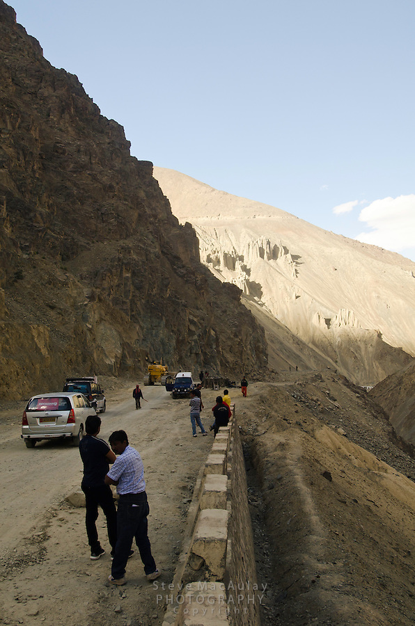 Heavy equipment clearing a rock slide that recently blocked the  Srinagar to Leh road. Mulbekh, Ladakh, India.