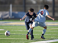 NWA Democrat-Gazette/CHARLIE KAIJO Bentonville West High School Kyle Chamblin (4) runs to a loose ball during a soccer game, Friday, March 15, 2019 at Bentonville West in Centerton.