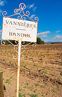 View over the vineyard in spring, sign with text Vannieres and Bandol Grape variety Cinsault and Mourvedre Chateau Vannieres (Vannières) La Cadiere (Cadière) d'Azur Bandol Var Cote d'Azur France