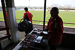 Stamford AFC 2 Marine 4, 29/03/2014. Wothorpe Road, Northern Premier League. Players make their way into the stadium and past the programme seller ahead of The Northern Premier League game between Stamford AFC and Marine from The Daniels Stadium. Marine won the game 4-2 in front of 320 supporters to boost their chances of relegation survival. Stamford AFC are moving to the brand new Zeeco Stadium at the end of the 2013/14 season Photo by Simon Gill.
