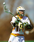 30 April 2011: University of Vermont Catamount midfielder Cal Case, a Junior from Columbus, OH, in action against the Stony Brook Seawolves at Moulton Winder Field in Burlington, Vermont. The Catamounts fell to the visiting Seawolves 12-9 to conclude their America East season. Mandatory Credit: Ed Wolfstein Photo