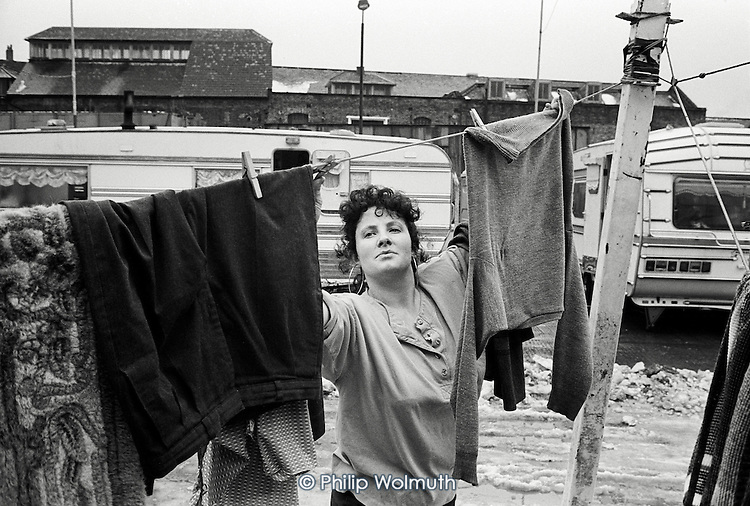 Maggie Joyce hangs out washing on Stafforrdshire Street Traveller site, Southwark, London.