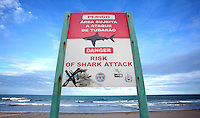 A sign warning of a risk of shark attacks on Boa Viagem beach in Recife, Brazil, one of the 12 host cities of the 2014 FIFA World Cup