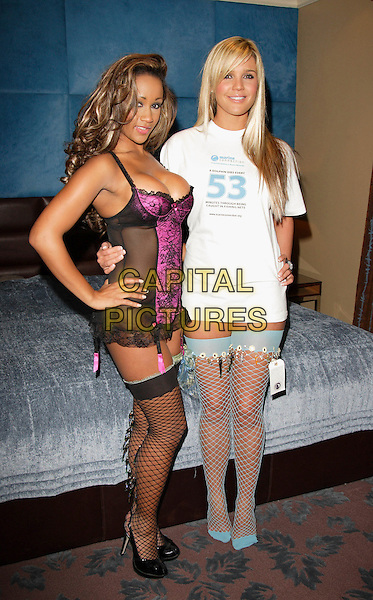 DANIELLE LLOYD & MODEL.At photocall to promote Marine Connection's Safety Nets Ball at the Mayfair Hotel, London,  England..October 25th 2007.full length t-shirt tee white stockings garter belt lingerie black pink sheer cleavage hand on hip blue fishnet .CAP/ROS.©Steve Ross/Capital Pictures
