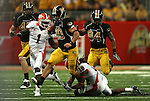 30 August 2008:      University of Missouri quarterback Chase Daniel (10, center) is tackled by University of Illinois defensive back Nate Bussey (18).  Other players shown (left to right) are Missouri tight end Chase Coffman (45), Illinois defensive back Vontae Davis (1) and Missouri wide receiver Tommy Saunders (84).  The 2008 State Farm Arch Rivalry game was played at the Edward Jones Dome in St. Louis, Missouri, August 30, 2008 with the Missouri Tigers coming into the game ranked 6th in the nation and The Fighting Illini ranked 20th.  Missouri defeated Illinois, 52-42.