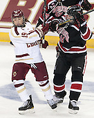 Danielle Doherty (BC - 19), Hayley Scamurra (NU - 14) - The Boston College Eagles defeated the Northeastern University Huskies 3-0 on Tuesday, February 11, 2014, to win the 2014 Beanpot championship at Kelley Rink in Conte Forum in Chestnut Hill, Massachusetts.
