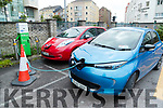Electric cars charging at Irish rail car park in Tralee.