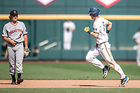 Michigan Wolverines first baseman Jimmy Kerr (15) jogs around the bases after his second home run in Game 11 of the NCAA College World Series against the Texas Tech Red Raiders on June 21, 2019 at TD Ameritrade Park in Omaha, Nebraska. Michigan defeated Texas Tech 15-3 and is headed to the CWS Finals. (Andrew Woolley/Four Seam Images)