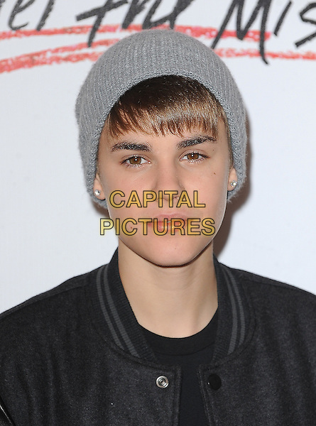 Justin Bieber.switches on Christmas lights and performs at Westfield London, Shepherds Bush, London, England..7th November 2011.headshot portrait black grey gray jacket beanie hat .CAP/BEL.©Tom Belcher/Capital Pictures.