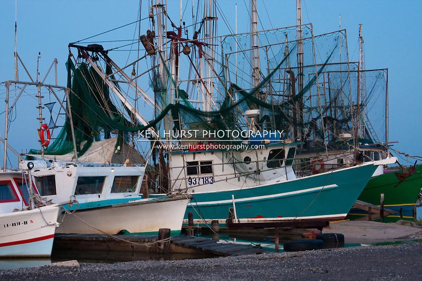 Shrimp boats lined up at dock in Cameron, Louisiana.