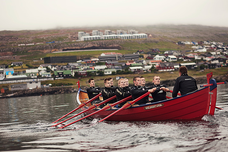 The men's rowing team from the town of Argir practice in the bay of Torshavn in the Faroe Islands on July 17,2009.  Argir, the top team in the country, were preparing for the national rowing championship held during the Ólavsøka celebration on July 29, which they won.