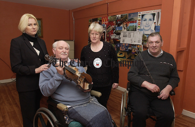 Friends of the late Jerome finucane whom  gathered at Irish Wheelchair Association's Resource Centre which was also  Jerome's place of work, they gathered to present to his wife Kathleen with a  specially commisioned piece hand made by Mr. Frank Chandler, Golf Links Rd.,  this was to mark Jerome's 40 years dedication to the Association. In the  photograph, from left to right were, Catherine Earley, C.D.O., Frank Harrigan,  friend, Kathleen Finucane wife of Jerome and Liam White, also a  friend. Missing  from the photograph is Marrita Nightingale, Supervisor. ..