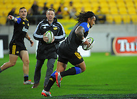 Ma'a Nonu scores from an intercept in the touch rugby warmup before the Super Rugby match between the Hurricanes and Chiefs at Westpac Stadium, Wellington, New Zealand on Saturday, 16 May 2015. Photo: Dave Lintott / lintottphoto.co.nz