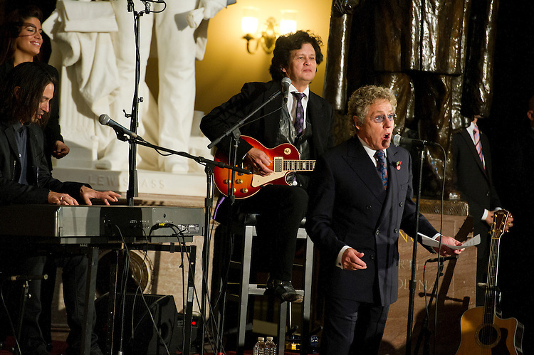 UNITED STATES - Oct 30: Roger Daltry, founder and lead singer of the British rock band The Who entertains the crowd during the ceremony to dedicate a bust of the late Prime Minister of the United Kingdom Winston Churchill, who became an honorary U.S. citizen in 1963. The event was held in the U.S. Capitol in Statuary Hall on October 30, 2013. (Photo By Douglas Graham/CQ Roll Call)