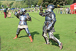 Frank O'Gorman and Brendan Griffin show their fighting skills while wearing 15th century suits of armour at the country fair at Oldbridge Estate on Saturday. www.newsfile.ie