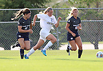 BROOKINGS, SD - August 19:  Tori Poole #21 from South Dakota State splits the defense of Karlee Campbell-Zollinger #6 and Kelsey Andersen #10 from Utah State during the first half of their match at Fischback Soccer Field in Brookings. (Photo by Dave Eggen/Inertia)