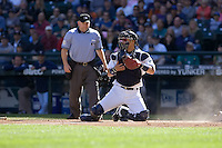 September 28, 2008: Seattle Mariners catcher Kenji Johjima scans the field for baserunners after receiving a late throw to home plate during a game against the Oakland Athletics at Safeco Field in Seattle, Washington.
