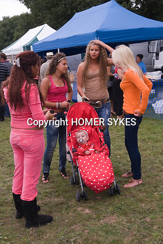 Barnet Gypsy Horse Fair Hertfordshire UK. Teen gypsy girls, teenage mother with baby. September annually for over 800 years.