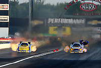 Aug. 30, 2013; Clermont, IN, USA: NHRA funny car driver Matt Hagan (left) races across the finish line alongside Ron Capps during qualifying for the US Nationals at Lucas Oil Raceway. Mandatory Credit: Mark J. Rebilas-