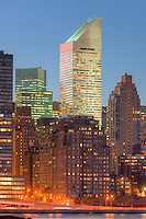 The Citigroup Building and other Manhattan buildings at twilight.