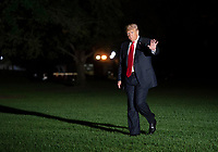 United States President Donald J. Trump waves to the press as he walks across the South Lawn as he returns to The White House in Washington, DC after attending political events in Erie, Pennsylvania on Wednesday, October 10, 2018.<br /> Credit: Chris Kleponis / Pool via CNP /MediaPunch
