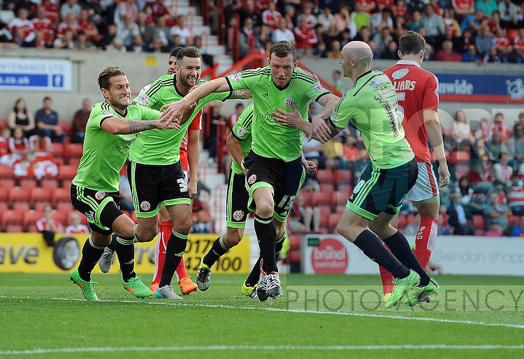 Neill Collins of Sheffield United celebrates scoring the opening goal of the game with team mate Billy Sharp of Sheffield United<br /> - Sky Bet League One - Swindon Town vs Sheffield United - The County Ground - Swindon - England - 29th August 2015