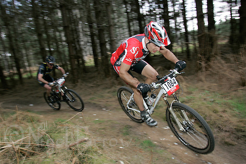 08 APR 2007 - THETFORD, UK - Robin Seymour leads Nick Craig through a singletrack section of the 100k race during round 1 of the British Mountain Bike Marathon series. (PHOTO (C) NIGEL FARROW)