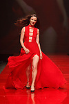 Actress Juliette Lewis walks runway in a red dress by Christian Siriano, for the Red Dress Collection 2017 fashion show, for The American Heart Association, presented by Macy's at the Hammerstein Ballroom in New York City on February 9, 2017; during New York Fashion Week Fall 2017.