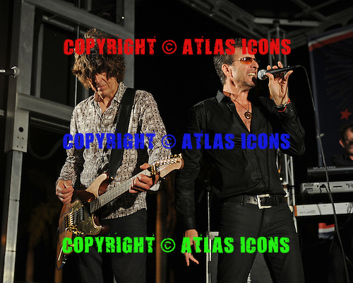 SUNRISE FL - JULY 04:  Cy Curnin and Jamie West-Oram of The Fixx perform during the City of Sunrise 4th of July Celebration held at  the BB&T Center on July 4, 2015 in Sunrise, Florida. (Photo by Larry Marano © 2015