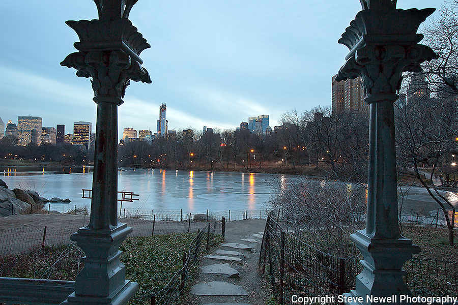 """""""Rambling Sunset"""" Central Park New York. I shot this scene in the days before the worst storm in 20 years blew in on a Friday and lasted through Sunday.  The Governors in several states banned driving personal vehicles on the public highways for a couple days.  Being from Lake Tahoe I came prepared for the storm and was excited to capture New York City and Central Park with fresh snow.  The contrast of the abundant tall buildings surrounding Central Park was surreal. The loud noise of the city's activity was replaced with the solitude of nature inside the parks boundaries. The birds enjoyed the exposed water in the ice ponds and weren't bothered in sharing the experience with their human companions visiting the park for the day. Many families took to the park to play in the fluffy deep fresh snow with sleds for the hills and entertaining snow ball battles. I still found myself at times insulated from the park visitors and the bustling city by the absolute quietness nature offers in the isolated mountains of  my home town. Black and white photography is still my favorite so you will see many images offered in Color and BW."""