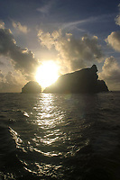 silhouette of Necker, at sunset, Northwestern Hawaiian Islands or the Leeward Islands, Papahanaumokuakea Marine National Monument, the largest marine wildlife reserve in the world, Hawaii, USA, Pacific Ocean