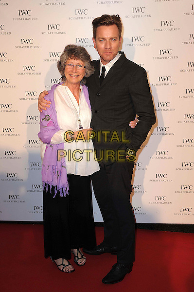 Carole Diane (née Lawson) & Ewan McGregor.IWC Filmmakers Dinner at Hotel Du Cap-Eden-Roc, 65th Cannes Film Festival, Cannes, France..May 21st, 2012.full length black suit white top purple scarf pashmina wrap mother mom mum son family .CAP/CAS.©Bob Cass/Capital Pictures.