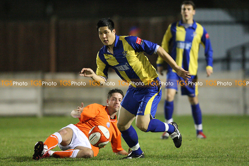 Hyun-Jin Lee of Romford evades Symonds of Braintree - Romford vs Braintree Town - Essex Senior Cup 3rd Round Football at Mill Field, Aveley FC - 01/11/11 - MANDATORY CREDIT: Gavin Ellis/TGSPHOTO - Self billing applies where appropriate - 0845 094 6026 - contact@tgsphoto.co.uk - NO UNPAID USE.