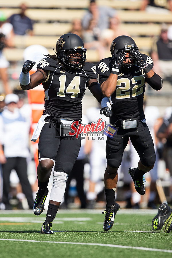 Wendell Dunn (14) of the Wake Forest Demon Deacons celebrates after making a stop on defense against the Army Black Knights at BB&T Field on September 20, 2014 in Winston-Salem, North Carolina.   (Brian Westerholt/Sports On Film)