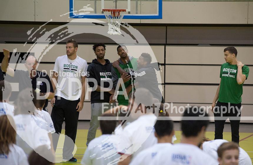 NBA coah Neal Meyer and Boston Celtics basketball players Jordan Mickey, David Lee, R. J. Hunter, Marcus Smart and James Young