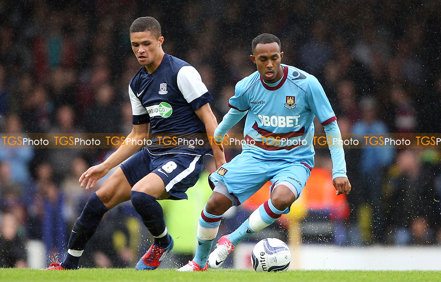 Kane Ferdinand of Southend and Rob Hall of West Ham - Southend United vs West Ham United, Pre-season Friendly at Roots Hall, Southend - 14/07/12 - MANDATORY CREDIT: Rob Newell/TGSPHOTO - Self billing applies where appropriate - 0845 094 6026 - contact@tgsphoto.co.uk - NO UNPAID USE..