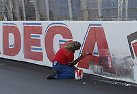Apr 28, 2007; Talladega, AL, USA; A track employee paints over tire marks on the wall following the Nascar Busch Series Aarons 312 at Talladega Superspeedway. Mandatory Credit: Mark J. Rebilas