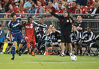 12 September 2012: Chicago Fire defender Arne Friedrich #23 and Toronto FC defender Ashtone Morgan #5 battle for a ball as Toronto FC head coach Paul Mariner shouts at the referee during an MLS game between the Chicago Fire and Toronto FC at BMO Field in Toronto, Ontario..The Chicago Fire won 2-1..