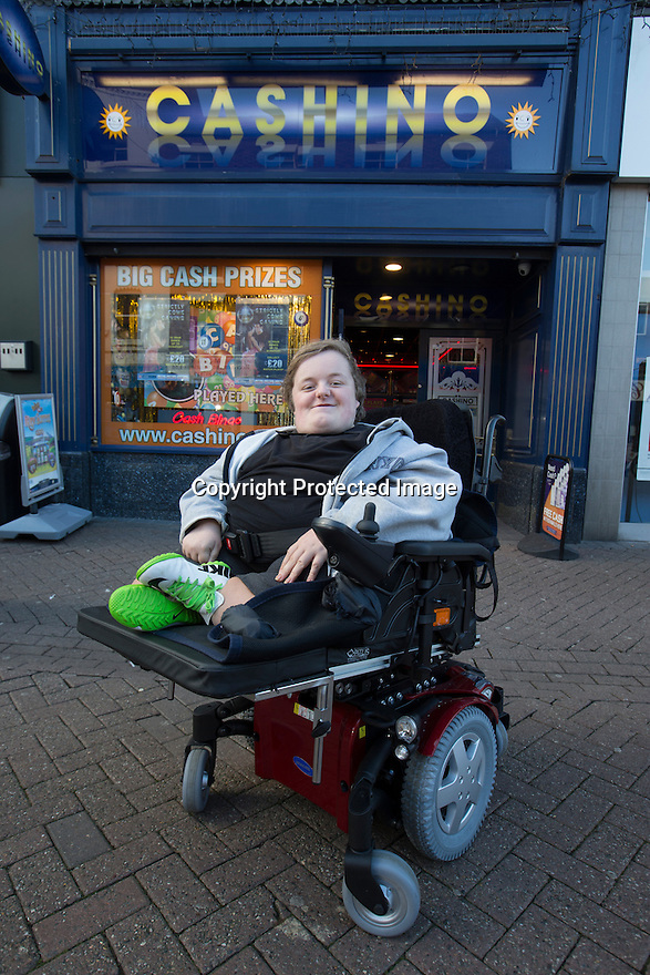 """20/11/15<br /> <br /> Thanks to the joint fundraising efforts of customers and staff at Cashino adult gaming centre on Station Street Burton-On-Trent, Arron Kent, a seventeen year old teenager from Swadlincote has received a new, customised powered wheelchair to help boost his mobility. <br /> <br /> Arron, who lives with his mum, Diane, dad Alan and sister Tabitha, suffers from Osteogenesis Imperfecta – a severe brittle bone disease which has seriously affected Arron's ability to walk. His condition means his bones break easily, often from mild trauma or with no apparent cause.  <br /> <br /> Arron currently has a basic powered wheelchair  but as his condition progresses the chair is becoming inadequate to meet Arron's growing needs. <br /> <br /> Arron's mum Diane said: """"We are very grateful to Cashino and CHIPS charity for providing Arron with a new state of art powered wheelchair. As he develops into adulthood, it is important that he maintains his independence, this powered wheelchair with features including adjustable height, tilt in space and excellent manoeuvrability will literally revolutionise Arron's life. <br /> <br /> Diane continues """"Arron is developing his hobby of showing rabbits and the rise and fall feature of his new wheelchair means he can now reach the judging tables without needing the assistance of another person.""""<br /> <br /> Cashino, which operates 155 adult gaming centres across the country, is one of the main fundraisers for CHIPS, a charity set up on behalf of the casino and gaming industry, which aims to provide specialised wheelchairs for children and young people with severe mobility problems.<br /> <br /> Janet Neal, manager of Cashino Burton-On-Trent, presented Arron with his new wheelchair last Friday, 20th November 2015.<br /> <br /> Speaking after the presentation, Janet Neal said: """"Arron is a lovely young man and is so deserving of this wheelchair. It makes all the fundraising efforts from all of our staff and customers here in """