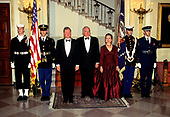 United States President Bill Clinton, left, Chancellor Helmut Kohl of Germany, center, and first lady Hillary Rodham Clinton, right, pose for a photo in front of the Grand Staircase of the White House in Washington, DC prior to an Official Dinner in the Chancellor's honor on Thursday, February 9, 1995.  <br /> Credit: John Harrington / Pool via CNP