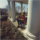 United States President John F. Kennedy plays with son John F. Kennedy, Jr. on the West Wing Collonade at the White House on March 28, 1963..Credit: White House / CNP