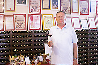 Zoran Vukoje the owner and winemaker with a glass of wine, in the winery tasting room. Vukoje winery, Trebinje. Republika Srpska. Bosnia Herzegovina, Europe.