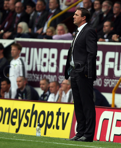 19.08.2011 Championship Football from Turf Moor. Burnley v Cardiff City. Malky Mackay watches attentively from the sideline